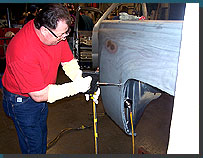 A student learning to use an electric dent puller